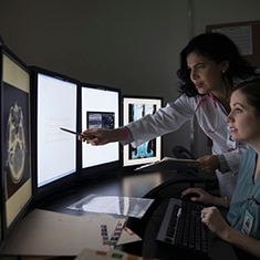 Imaging specialist reviewing CT images
